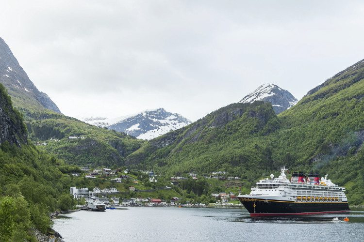 "GEIRANGER, Norway (June 10, 2015) – Today, the Disney Magic arrived in Geiranger, Norway, for the first time in forever, sailing into the majestic fjord that inspired the fairytale kingdom of Arendelle in the animated hit ""Frozen."" The Disney Magic called on Geiranger as part of the inaugural Norwegian Fjords itinerary that kicks off the 2015 European season. (Matt Stroshane, photographer)"