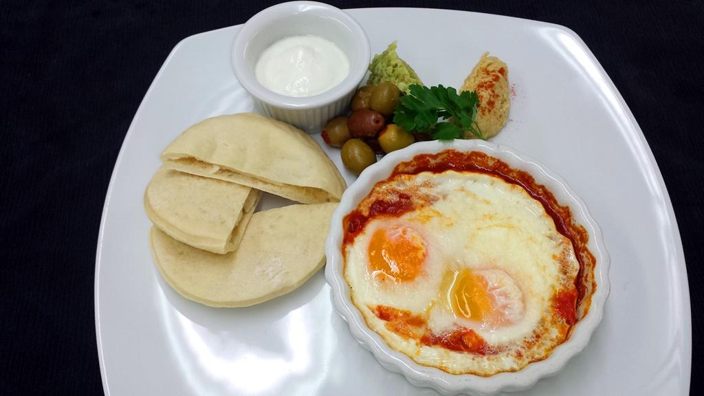 16 Arabic Shakshuka Hummus, Olives, Warm Pita Bread, Foul Moudamas and Labneh