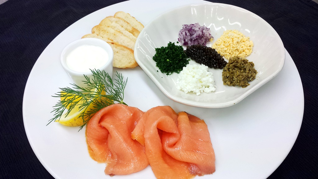 8 Chilled half oz Bowfin Caviar Norwegian Smoked Salmon, condiments and toast